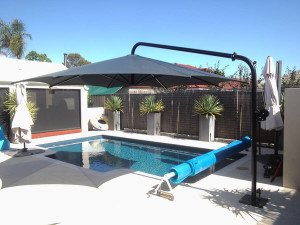 canter lever umbrella over pool